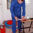Plumber using a workbench — Stockfoto