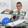 Contractor holding model — Stock Photo