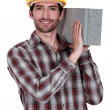 Builder with a concrete block — Stock Photo