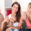 Three girlfriends drinking wine together — Stock Photo #8049598