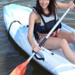 Teenage girl doing canoe — Stock Photo #8049609