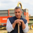 Stock Photo: Farmer standing in front of a cattle transport vehicle
