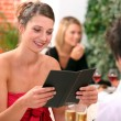 Couple ordering at restaurant — Stock Photo #8049939