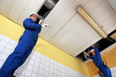 Electricians wiring a large room — Stock Photo
