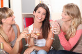 Three girlfriends drinking wine together — Stock Photo