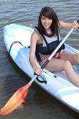 Teenage girl doing canoe — Stock Photo