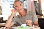 Man on the phone having coffee — Stock Photo