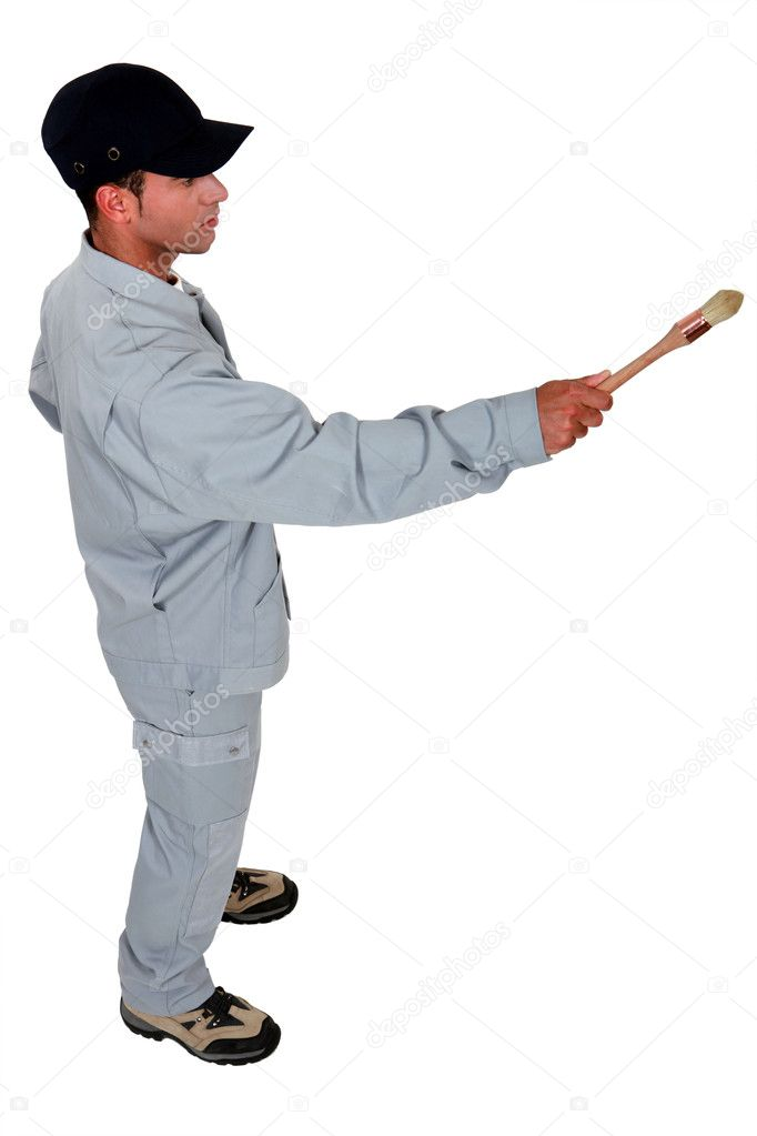 Decorator holding paint brush — Stock Photo #8048919