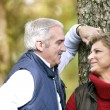 Stock Photo: Loving couple enjoying romantic walk in park
