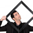 The man in the picture frame — Stock Photo