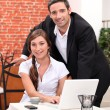Couple in a restaurant working on a laptop — Stock Photo #8051013