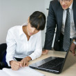 Businessman discussing something with his secretary — Stock Photo #8051208