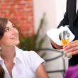 Stock Photo: Waiter pouring champagne