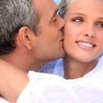 Husband kissing wife — Stock Photo #8051434