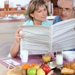 Middle-aged couple reading - Stock Photo