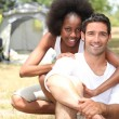 A couple in front of their tent — Stock Photo #8051805