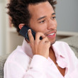Man at home speaking on telephone — Stock Photo #8051924