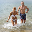 Couple running in the sea — Stock Photo #8051991