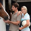 Young couple at a stable - Stock Photo