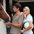 Young couple at stable — Stock Photo #8052015