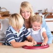 Parents playing with their kids — Stock Photo #8052316
