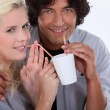 Couple drinking from the same cup — Stock Photo