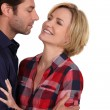 Stock Photo: Couple stood closely looking each other in eyes