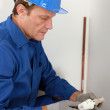 Plumber with a radiator valve — Stock Photo