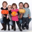 Portrait of kids with pumpkins — Stock Photo