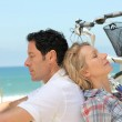 Couple alseep with bikes by the sea — Stock Photo #8054853