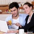 A modern couple having breakfast. - Stock Photo