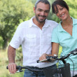 Couple riding bikes — Stock Photo #8058692