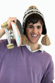 Young man carrying a skateboard — Stock Photo