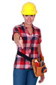 Female worker holding out hand — Stock Photo