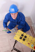 Male plumber using tape measure — Stock Photo