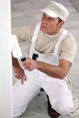Tradesman painting a wall — Stock Photo
