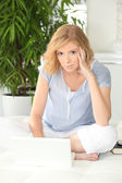 Young woman relaxed using laptop at home — Foto de Stock