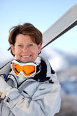 Woman going skiing — Stock Photo