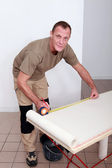 Man measuring wallpaper — Stock Photo