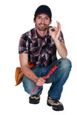 A handyman making an ok sign. — Stock Photo