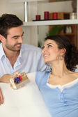 Man giving his girlfriend present — Stock Photo