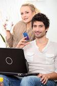 Couple doing online shopping. — Stock Photo