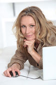 Smiling relaxed woman with laptop computer — Stock Photo