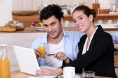 A modern couple having breakfast. — Stock Photo
