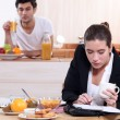 Young active couple having breakfast — Stock Photo