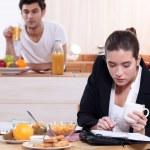 Young active couple having breakfast — Stock Photo