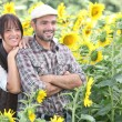 Couple in a sunflower field — Stock Photo #8061815