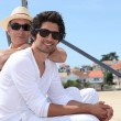 Father and son at beach wearing sunglasses — Stock Photo