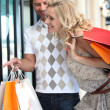 Couple go on shopping spree — Stock Photo #8062332