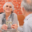 Stock Photo: Older couple toasting at restaurant